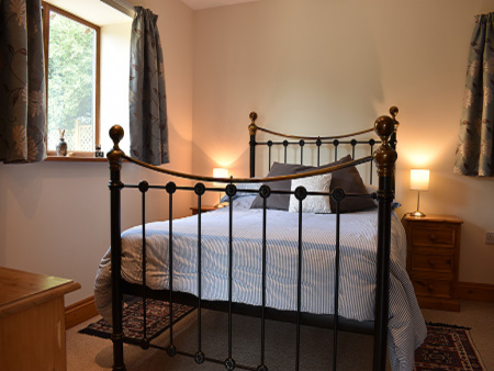 Double bed in converted barn